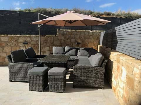 Private terrace with luxury seating perfect for alfresco dining.