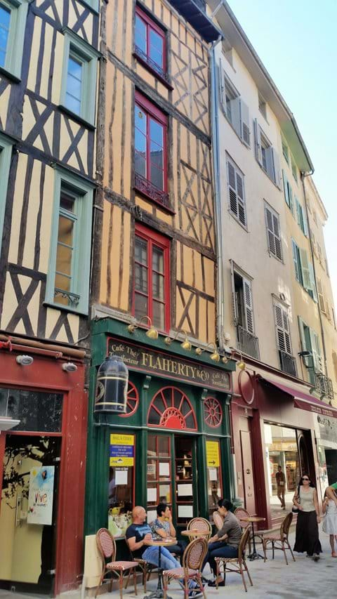 Narrow medieval street in Limoges, narrow with 4 stories and wood crossing the wallsree r