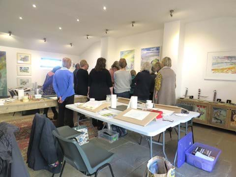 Students watching Rob demonstrate watercolour techniques