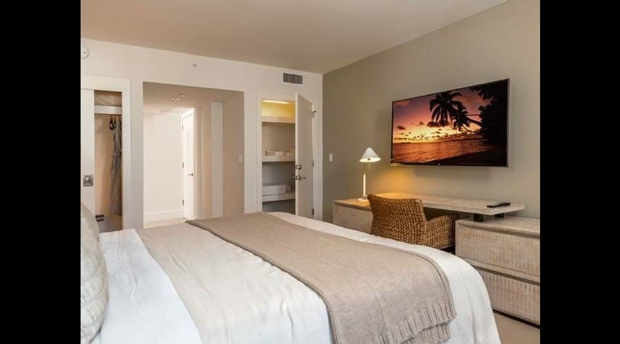 """Beautifully furnished bedroom with smart Samsung tv"""