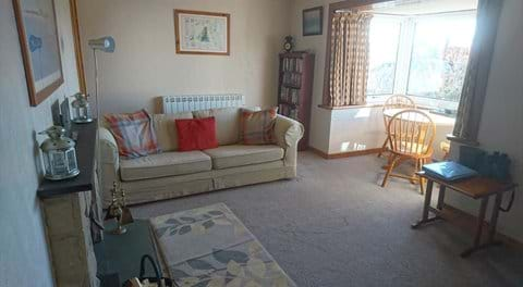 Living room with sunny dining area to watch the the tide coming in and out