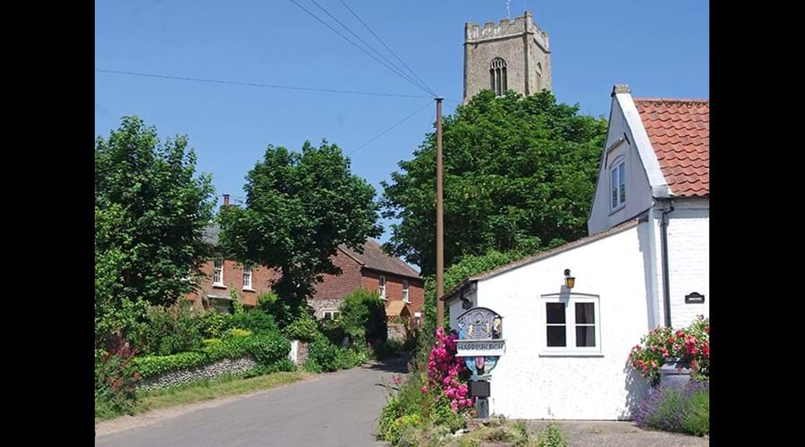 Happisburgh village sign and a glimpse of Albion cottage