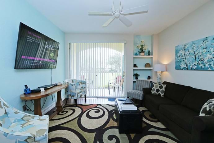 "Light and airy living area at 13-102 with 46"" TV, Queen sofa bed, ceiling fan  and air con"