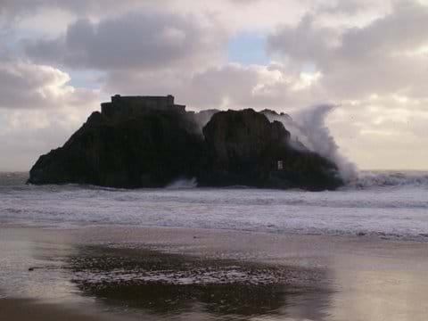Waves breaking over St Catherine's