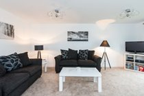 Spacious and airy living space with ample seating for six