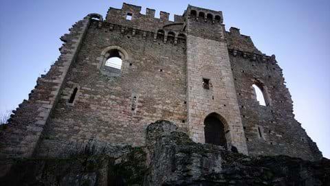 Stone ruins of Chalucet castle against dull December sky