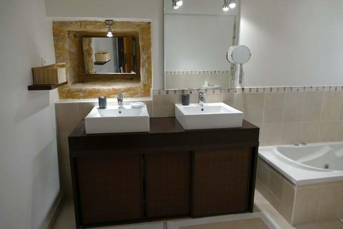 En suite bathroom for Bedroom One with double vanity unit