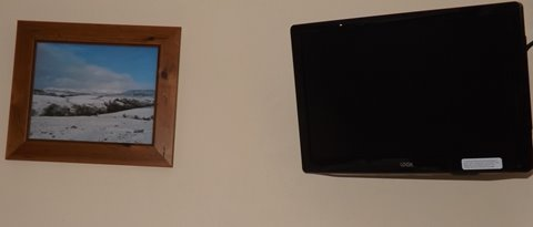 Smart HD TV and integral DVD player in second bedroom