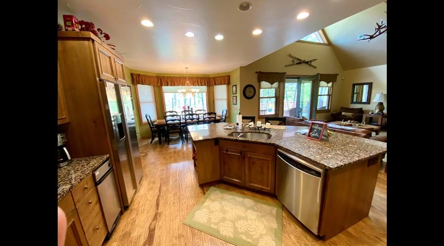 Open floor plan kitchen faces great room and deck