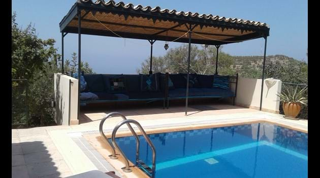 The pool with comfortable covered seating area