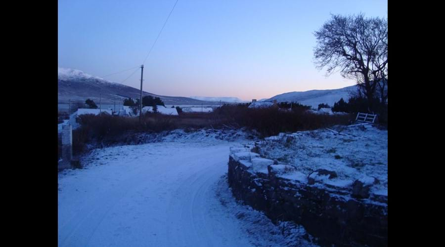 View down the lane in the snow