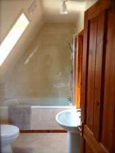 The Bathroom has a bath & shower with access from master bedroom and hall. Bathroom recently fitted