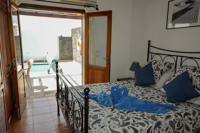 Bedroom 1 - doors to Pool Area