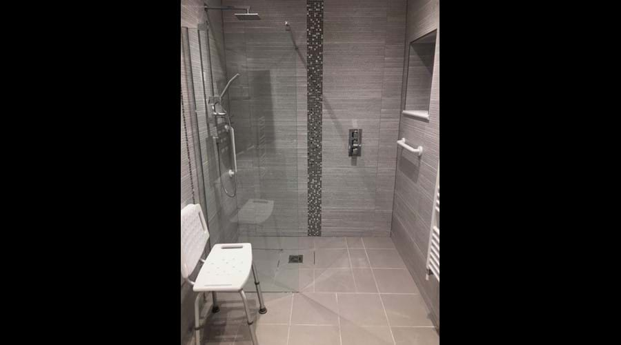 Disabled friendly ensuite wetroom to groundfloor double with thermostatic shower and shower chair