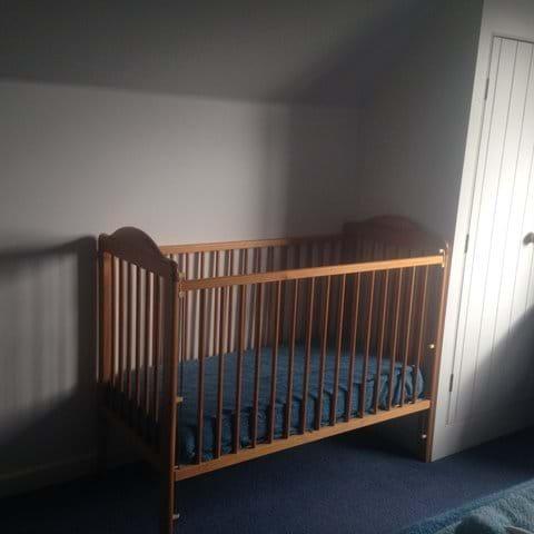 Cot in master bedroom