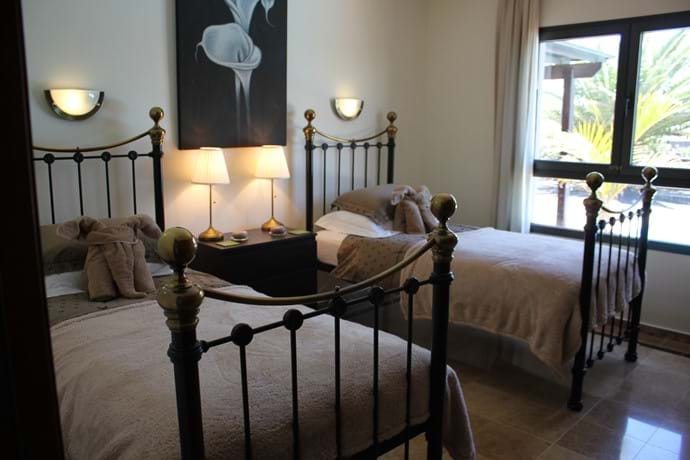 Bedroom 2 - two super comfy single beds & access to main family bathroom