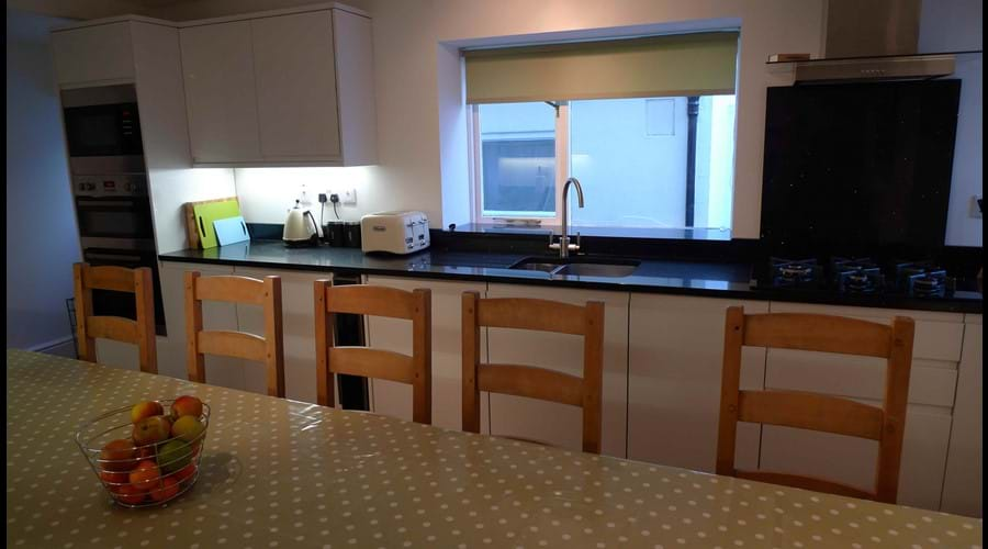 Double electric oven, built-in microwave, dishwasher, gas hob, wine chiller, kettle, 4 slice toaster