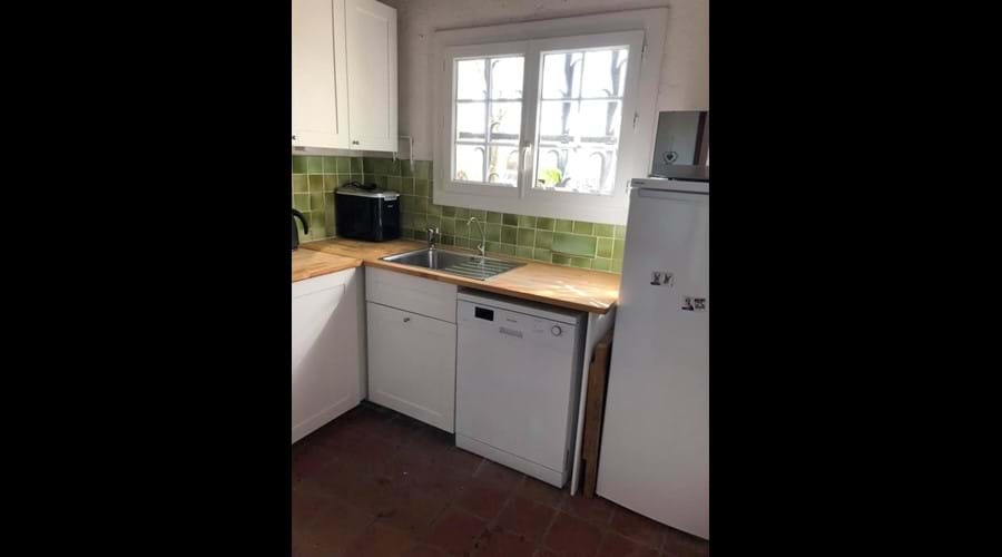 The kitchen in the house