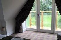 The master bedroom looking toward the balcony