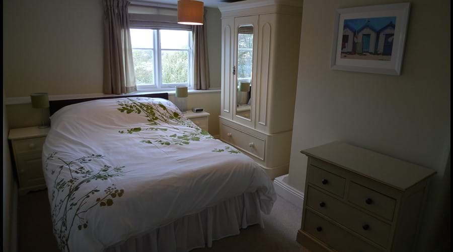 Bedroom 3:  Double bed with wardrobe, chest of drawers, dressing table and side tables