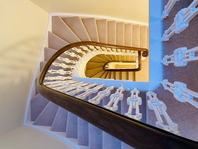 Beautiful, light staircase leading up to the second floor
