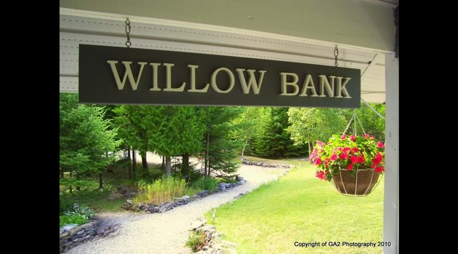 The Willow Bank sign by the rear entrance welcomes visitors to the cottage.