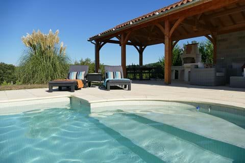 Superb pool 11m x 5m with Roman steps and rattan loungers