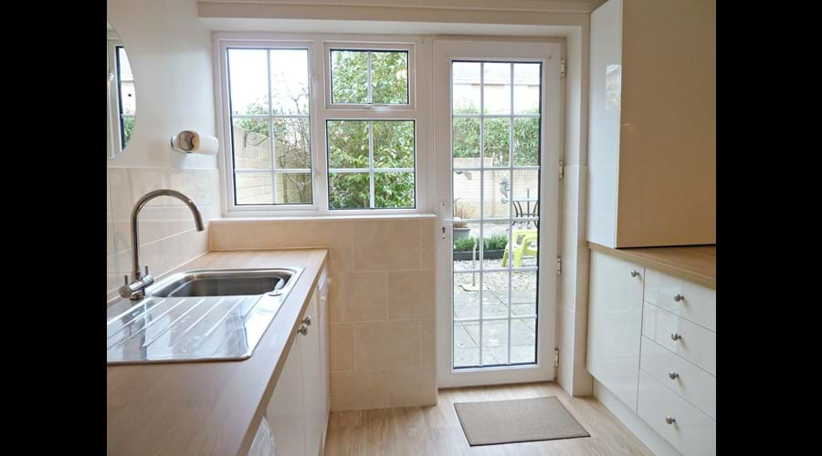 Newly fitted kitchen with direct access to rear garden.