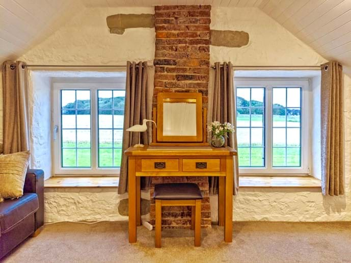 There is a fabulous view from the master bedroom across the field to the Pele Tower opposite