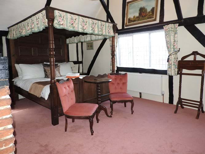 Main bedroom with kingsize four poster bed