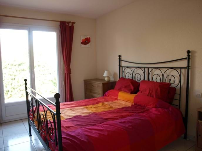 Downstairs double bedroom with French doors to the garden, and a spacious ensuite shower room