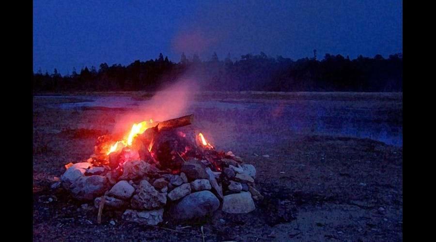 Most children enjoy roasting marshmallows or a hot dog around an open camp-fire.