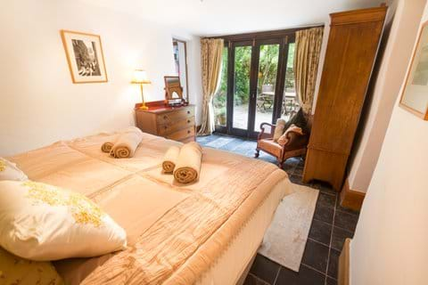 Ground floor bedroom with double bed and French Windows in a North Devon holiday cottage