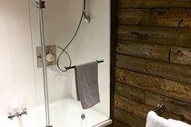 Power shower over bath, Chapel Bay Lodge