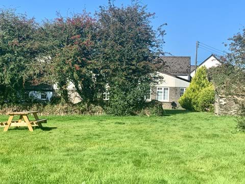 Rear Garden and playing field. Picnic area