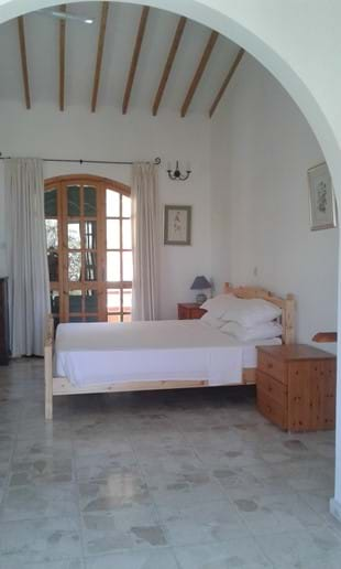 The master bedroom with superking bed. Windows and French windows on 3 aspects.