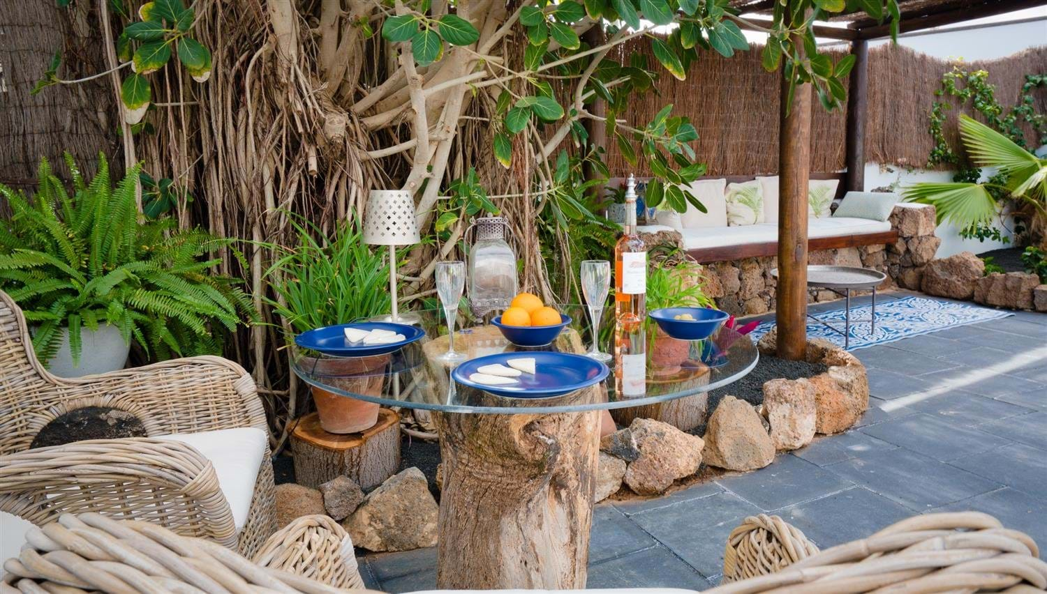 Outdoor dining on a tree stump table at Finca Botanico in Lanzarote