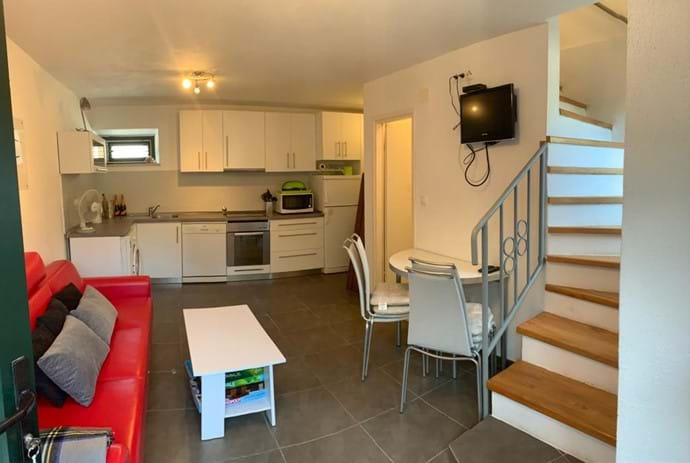 Downstairs WC, television in living area and new fitted kitchen
