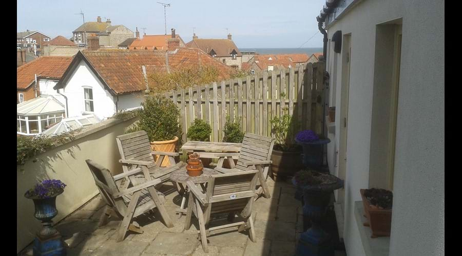 "West terrace - outside the main bedroom. Note the ""Blackpool landlady"" sea view on the horizon!"