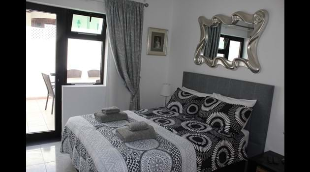 Bed 2 has a double bed with en-suite shower + toilet and its own private patio
