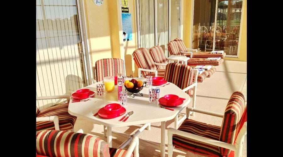 Outdoor Entertainment Area - Relax in the sun on comfortable sun loungers