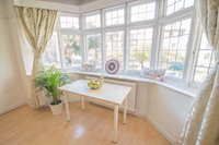 Nice table in one  of the double bedrooms with large windows that flood in light