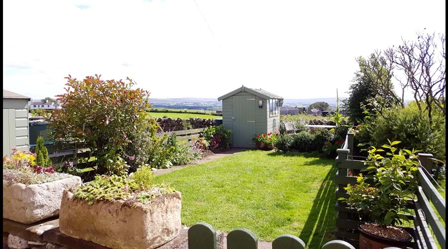 Fully enclosed south facing garden with seating areas to enjoy the far reaching views across farmland and countryside....