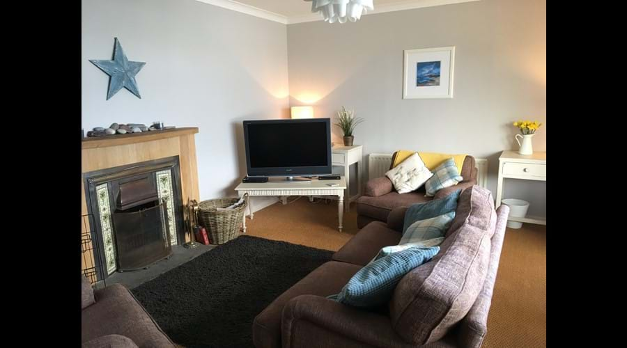 Large, spacious lounge with open fire. Large screen TV with freeview, blue-ray / DVD, Wii games console, and chromecast. Wifi.