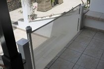 This shows the sliding gate to keep toddlers away from the steps to the front patio