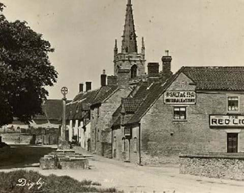 The Red Lion pub and preaching cross, Digby