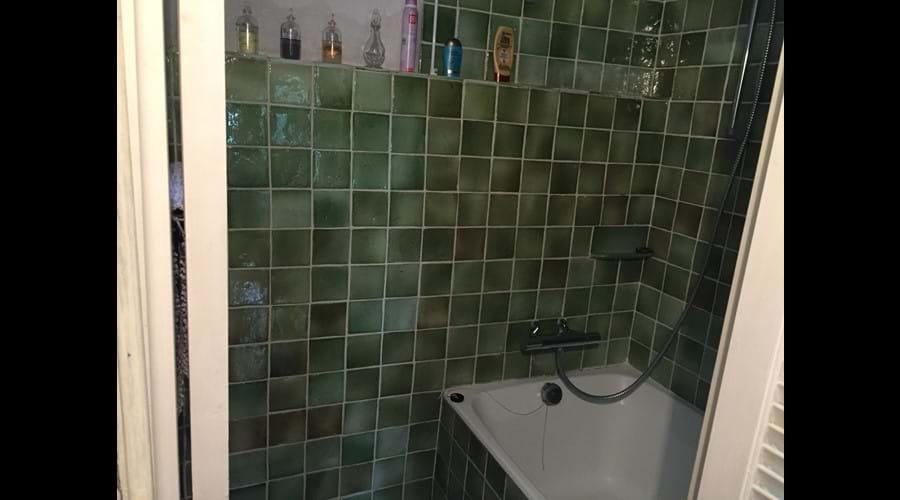 Downstairs shower over half-size bath!