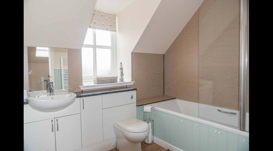 Main spacious family bathroom with bath and over bath shower