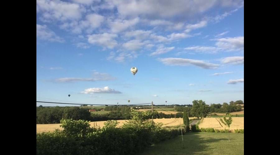 Balloons over neighbouring fields