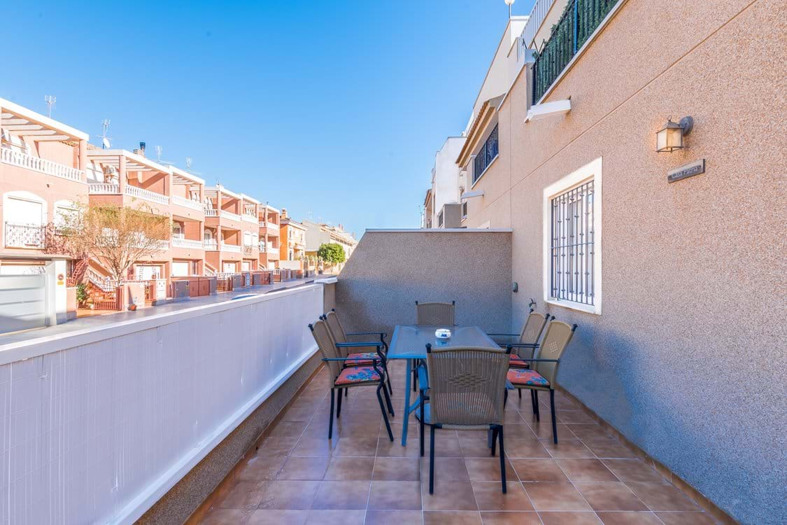 Large patio area with furniture. Perfect for dining and/or relaxing outside